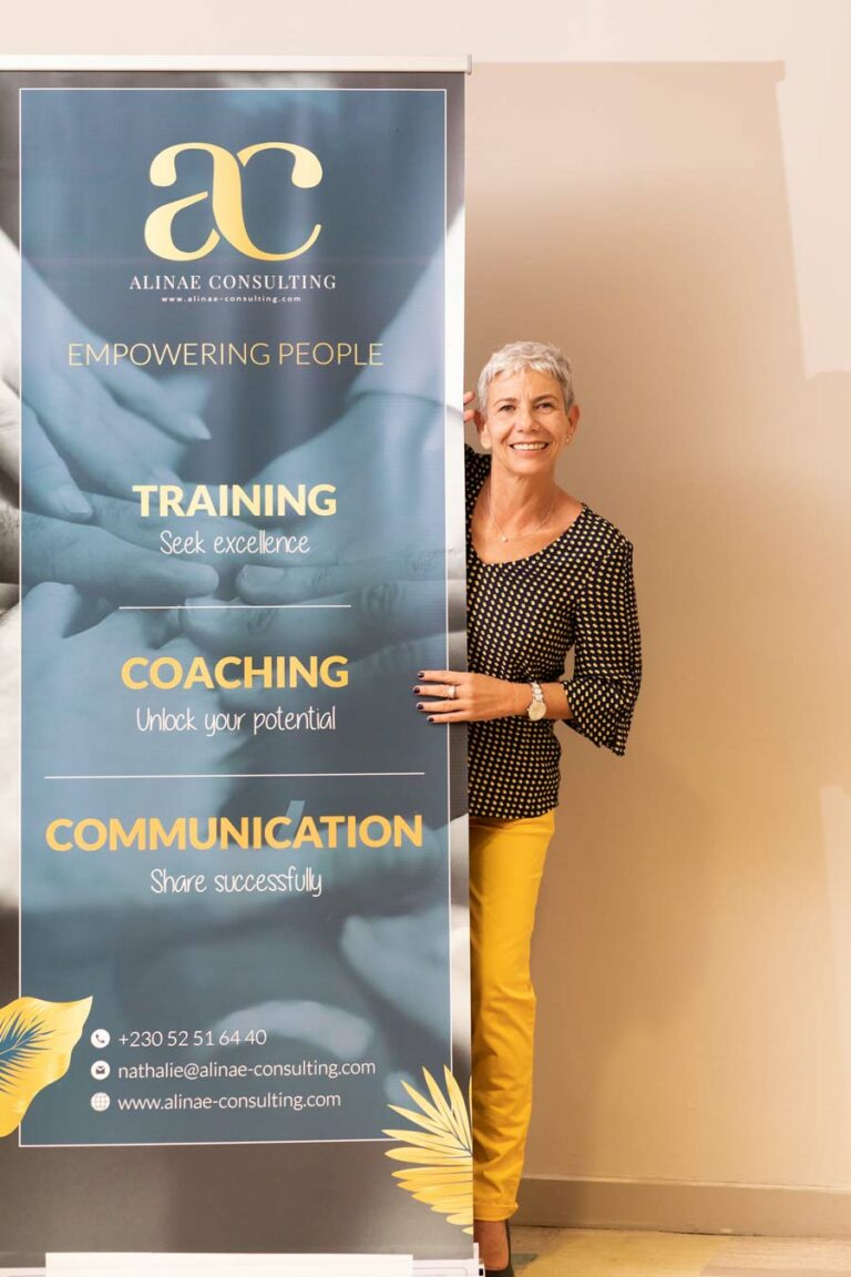 Nathalie Sanchez with roll-up for the 5th anniversary of Alinae Consulting